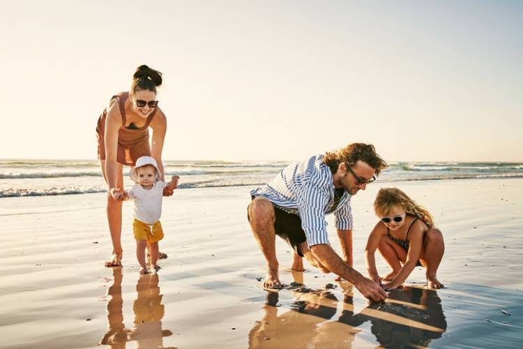 A family enjoys a day out on the beach